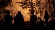 Buddhist monks silhouettes at village fireworks festival / Northern Thailand